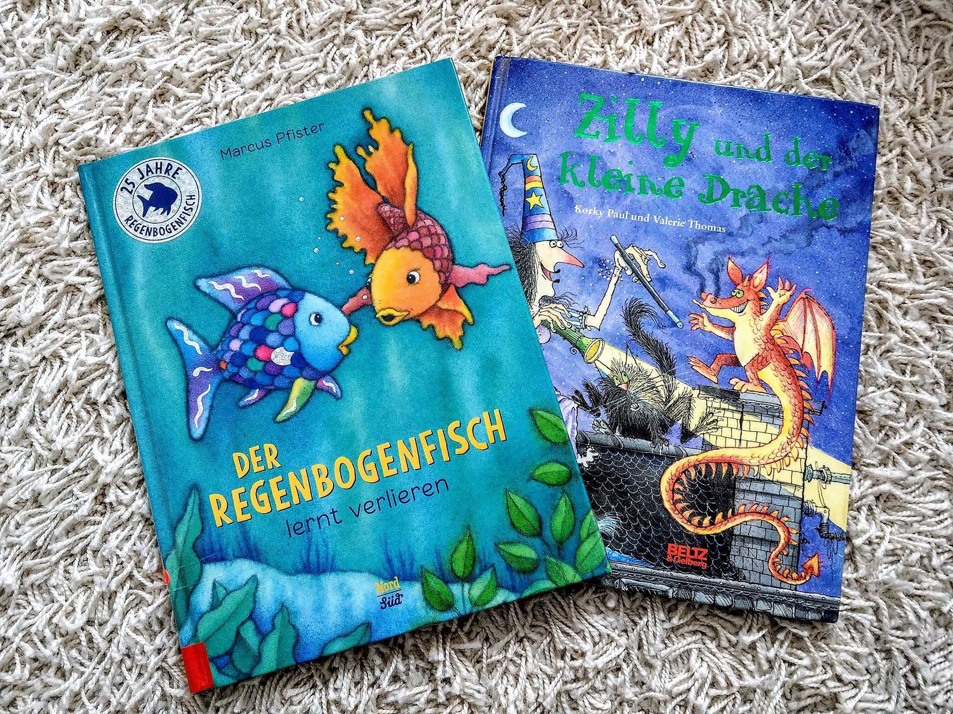 """Die Lieblingsbuecher der Freitagslieblinge am 23.3.18 sind die Kinderbuecher """"Der Regenbogenfisch lernt verlieren"""" und """"Zilly und der kleine Drache"""""""